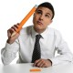 Young businessman student thinking gesture with huge giant pencil