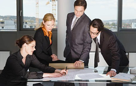 Businesspeople around desk